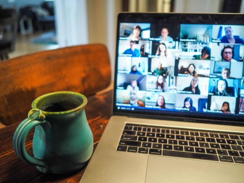 Coffee mug to the side of a laptop screen showing video conference in progress