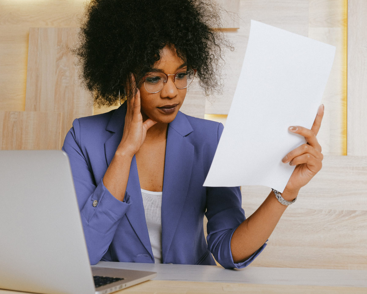 Confused Woman Holding Paper Cover Letter